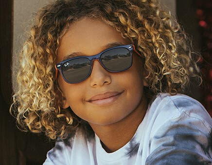 ray ban kids glasses featuring the ray ban rj9062s kids sunglasses in matte black with flash blue lenses