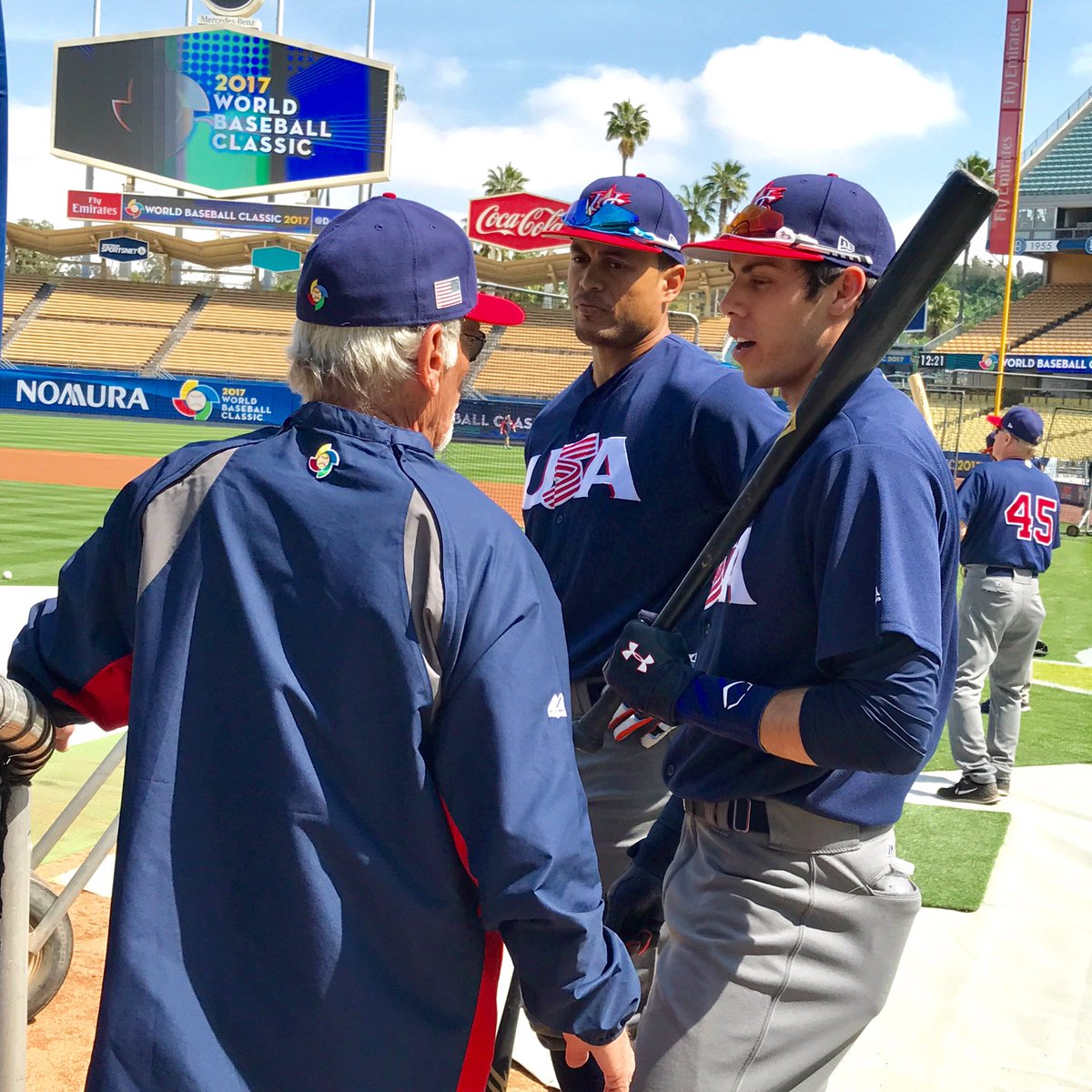 Team USA's Christian Yelich and Giancarlo Stanton wearing Oakley and Under Armour glasses preparing for their game vs Japan